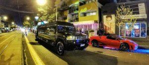Black limo and ferrari