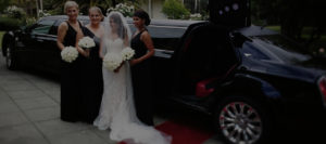 Bride in front of limousine