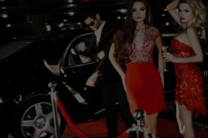 Girls in red Dress in Front of Black Limo and Chauffeur