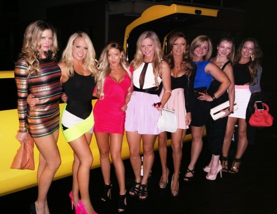 girls-standing-in-front-of-limo
